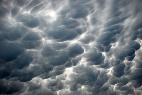 Mammatous or Lactial Storm Clouds: These clouds denote gradual movement of a low front across a basin or plain, with tiny figures in the distance suffering ill luck or worse, magnified by grandiose indifference of universal aspects and surrounding life forms such as crows, ants, telephone poles, and mailboxes.