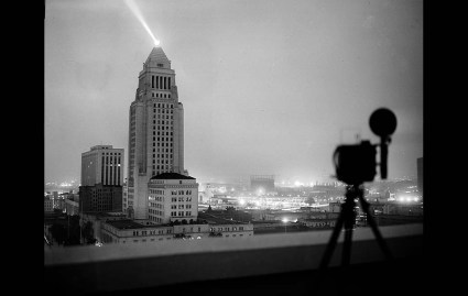 May 7, 1952: View of Los Angeles City Hall lite up at 5:15 a.m. as A-Bomb is exploded in Yucca Flat, Nevada, some 300 miles away. This photo was published in the May 8, 1952 Los Angeles Times. The Lindbergh Beacon projects the ray of light from a top City Hall.